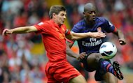 Liverpool midfielder Steven Gerrard (left) vies with Arsenal&#39;s Abou Diaby during the Premier League match between Liverpool and Arsenal at Anfield in Liverpool. Arsenal ended their goal drought in emphatic fashion as Lukas Podolski and Santi Cazorla inspired an impressive 2-0 win at Liverpool