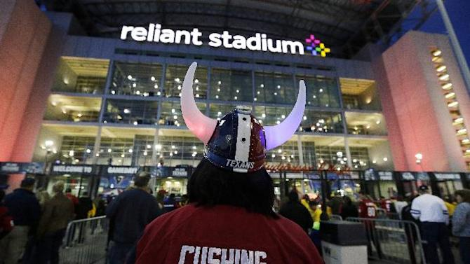 Fans arrive for a night NFL football game between the Houston Texans and the Indianapolis Colts, Sunday, Nov. 3, 2013, in Houston