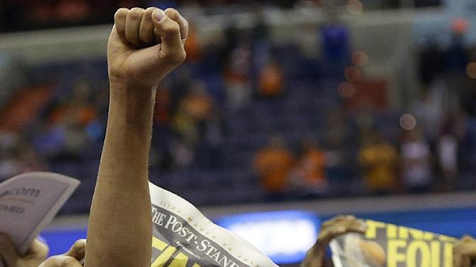 Syracuse guard Michael Carter-Williams celebrates after their 55-39 win over Marquette in the East Regional final in the NCAA men's college basketball tournament, Saturday, March 30, 2013, in Washington. (AP Photo/Pablo Martinez Monsivais)