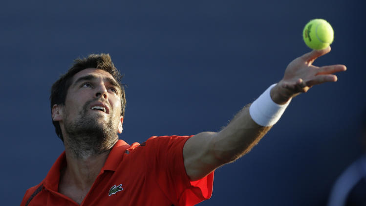 Jeremy Chardy, of France, tosses the ball as he serves to Blaz Kavcic, of Slovenia, during the second round of the 2014 U.S. Open tennis tournament Wednesday, Aug. 27, 2014, in New York. (AP Photo/Darron Cummings)
