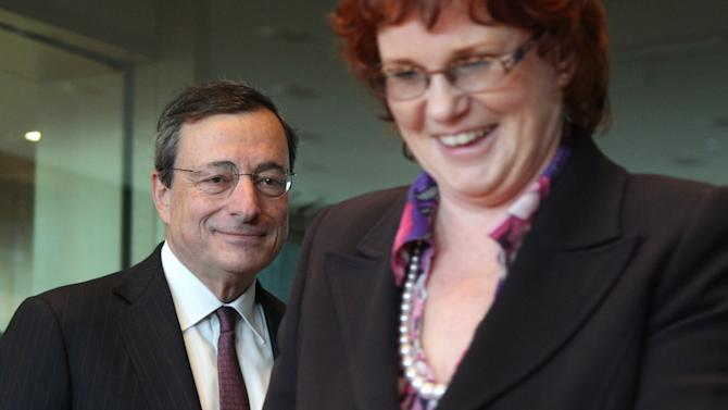 President of the European Central Bank Mario Draghi, left, arrives with chairwoman of the Committee Sharon Bowles, of England, prior to the start of the Economic and Monetary Affairs Committee meeting in Brussels, Belgium, Monday Feb. 18, 2013.  (AP Photo/Yves Logghe)