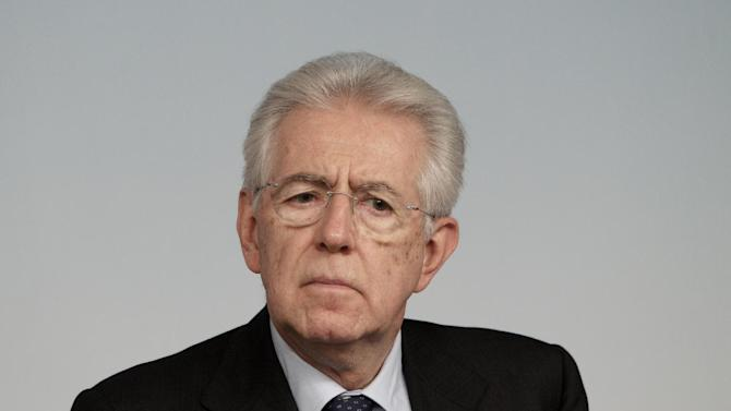 Italian Premier Mario Monti listens to a question during a press conference at the end of a cabinet meeting at Chigi Palace government's office in Rome, Thursday, Dec. 6, 2012. Concerns over the stability of the Italian government grew on Thursday after Silvio Berlusconi's party withdrew its support, threatening to bring a premature end to Premier Mario Monti's ambitious reforms program. Berlusconi's center-right PDL party abstained from a confidence vote in the Senate on Thursday. Though Monti's government of unelected technocrats won the vote by 127 to 17, investors fear the move heralds a period of political uncertainty in the run-up to planned elections next year. (AP Photo/Riccardo De Luca)