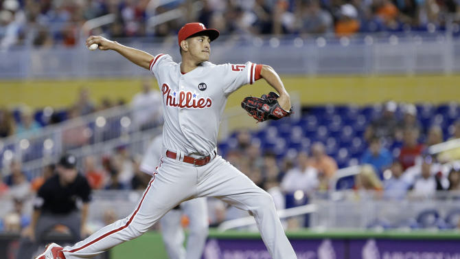 Philadelphia Phillies' Severino Gonzalez delivers during the first inning of a baseball game against the Miami Marlins, Sunday, May 3, 2015, in Miami. (AP Photo/Wilfredo Lee)