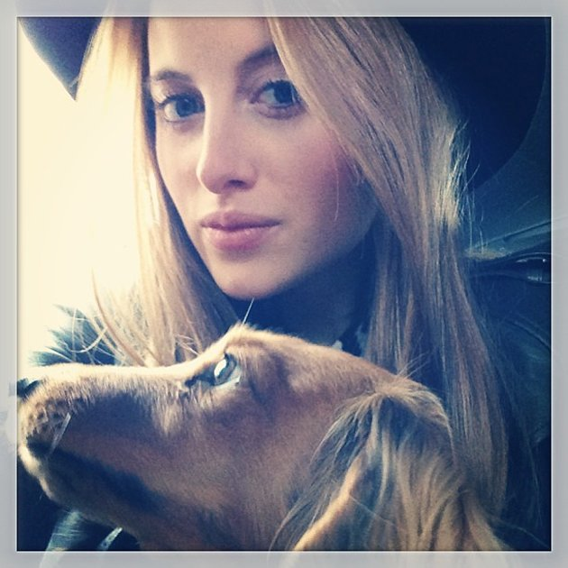 Made in Chelsea's Rosie Fortescue cuddles up to her dog, Noodle. Copyright [Instagram]