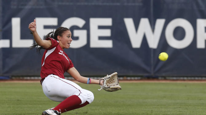 Oklahoma center fielder Destinee Martinez makes a sliding catch on a fly ball hit by Tennessee's Melissa Davin for the out in the second inning of the second game of the best of three Women's College World Series NCAA softball championship series in Oklahoma City, Tuesday, June 4, 2013. (AP Photo/Sue Ogrocki)