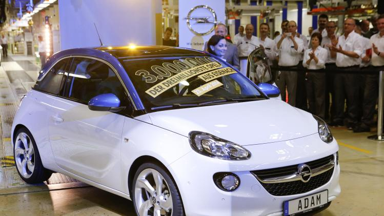 An Opel Adam car is presented during a ceremony as the 3rd million car produced at the Opel plant in Eisenach