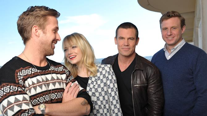 """FILE - In thsi Dec. 15, 2012 file photo, from left,  actor Ryan Gosling, actress Emma Stone, actor Josh Brolin and director Ruben Fleischer from the film """"Gangster Squad,"""" pose for a portrait at the Four Seasons Hotel, in Beverly Hills, Calif. (Photo by John Shearer/Invision/AP, File)"""
