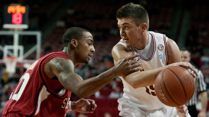 Arkansas guard Rotnei Clark, right, looks to pass around Southeast Missouri State guard Anthony Allison, left, during the first half of an NCAA college basketball game in Fayetteville, Ark., Wednesday, Nov. 24, 2010. (AP Photo/April L. Brown)