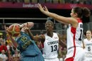 Canada's Tatham and Achonwa guard Australia's Jackson during their women's preliminary round Group B basketball match at the Basketball Arena during the London 2012 Olympic Games