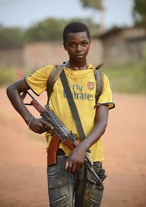 A young anti-Balaka combattant stands guard in a street …