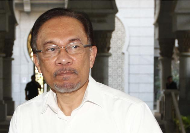 Malaysian opposition leader Anwar Ibrahim arrives at a court house in Putrajaya