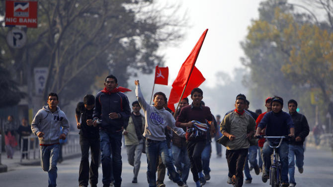 Members of the splinter faction of the Unified Communist Party of Nepal Maoist shout slogans against the government during a general strike Katmandu, Nepal, Wednesday, March 6, 2013. The strike called to protest the decision to form an interim government led by the Supreme Court chief justice disrupted normal life in the city. Nepal's quiet, barely known chief justice is on the verge of taking almost total control of the Himalayan nation, becoming the interim head of government as well as the top judge in a country that has been without a legislature for months. (AP Photo/Niranjan Shrestha)