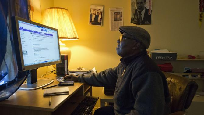 Liberian-American Moses Jensen, founder of the organization Immigrant Information Center, at his apartment in the Clifton neighborhood of Staten Island, New York