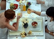 Guests attend the 2012 Diner en Blanc in New York City. The upmarket French picnic organiser which said popular Singapore delicacies were not welcome at its debut event in the city-state was forced to eat humble pie