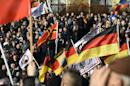 Supporters of the Pegida movement (Patriotic Europeans Against the Islamisation of the Occident) gather in Dresden, eastern Germany, on February 6, 2016
