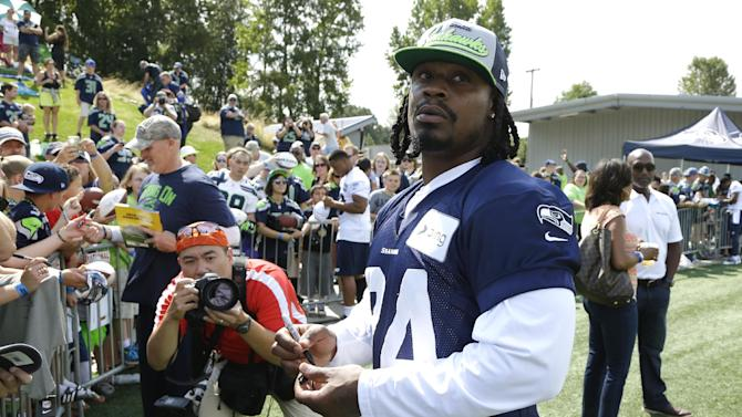 Back at camp, Lynch watches Seahawks practice
