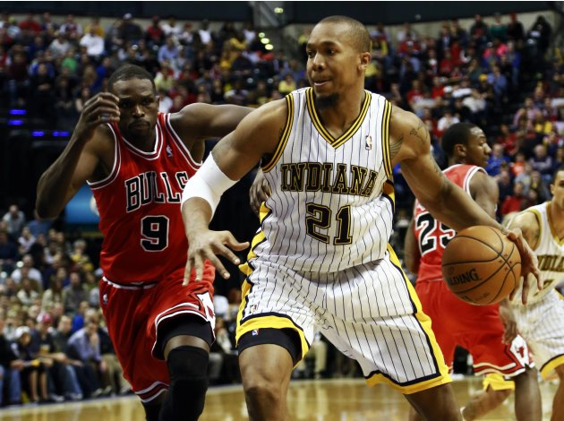 Indiana Pacers' West goes to the basket pursued by Chicago Bulls' Deng during an NBA basketball game in Indianapolis