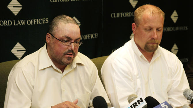 John Jentz, left, of St. Peter, Minn., and Robert Schmidt, of Hutchinson, Minn., who were both severely burned in April 2010 at a grain elevator explosion in downstate Illinois, speak about their settlement at a news conference at Clifford Law Offices Monday, June 4, 2012, in Chicago. Jentz described his losses after a federal jury awarded him $75 million in a lawsuit against ConAgra Foods Inc. and a subcontractor. Jentz, Schmidt and a third victim from Iowa were awarded a total $181 million in damages. (AP Photo/M. Spencer Green)
