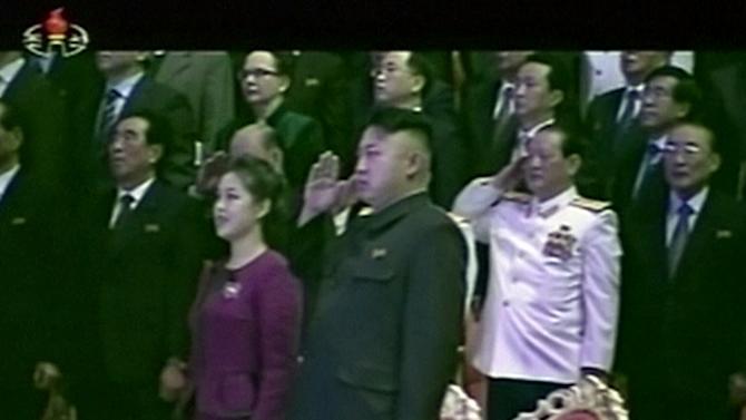 In this Tuesday, Jan. 1, 2013 image made from video, North Korean leader Kim Jong Un, center right, salutes as he and his wife Ri Sol Ju, center left, attend a New Year's concert in Pyongyang, North Korea. The seemingly pregnant belly sported by the wife of North Korean leader Kim Jong Un in mid-December appeared to be gone by New Year's Day. That's sent South Korean media into a frenzy of speculation that there's a new baby in the ruling Kim dynasty. (AP Photo/KRT via AP Video) TV OUT, NORTH KOREA OUT
