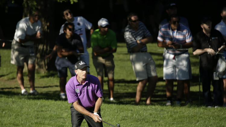 Jim Furyk watches his shot out of the rough on the 16th hole during the third round of the PGA Championship golf tournament at Oak Hill Country Club, Saturday, Aug. 10, 2013, in Pittsford, N.Y. (AP Photo/Charlie Riedel)