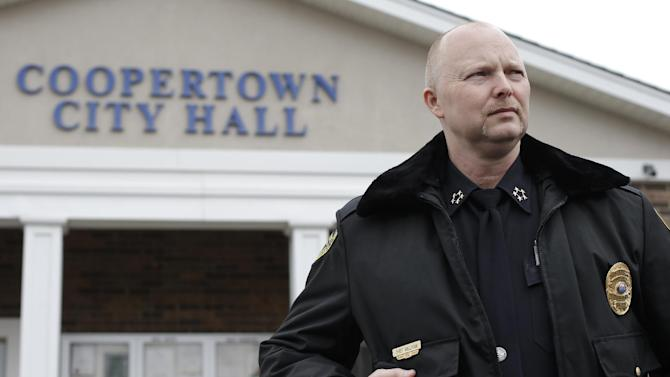 This Feb. 13, 2013 photo shows Coopertown, Tenn., Police Chief Shane Sullivan at the Coopertown City Hall. The department was disbanded for several months last year after an officer was recorded using a racial slur to describe a black motorist. Sullivan, hired in Nov. 2012, is counting on using a lie-detector test to keep racists off his tiny police force. (AP Photo/Mark Humphrey)