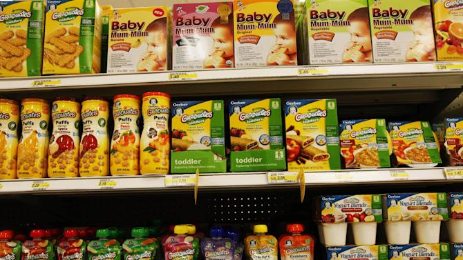 Gerber® Graduates® Grabbers™squeezable fruit or fruit/vegetable pouches made with natural fruits and vegetables sit on the shelf next to other baby food products in the baby food aisle in City Target on Thursday, Jan. 3, 2013, in downtown Los Angeles. Though they can be more expensive, pouches are beloved by parents who can let their kids feed themselves at a young age. (AP Photo/Nick Ut)