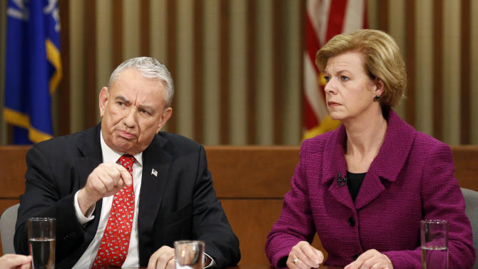 Republican candidate for U.S. Senate, former Wisconsin Gov. Tommy Thompson, left, and Democratic candidate, U.S. Rep. Tammy Baldwin, participate in a debate at Marquette University Friday, Oct. 26, 2012, in Milwaukee. (AP Photo/Joel Phelps)