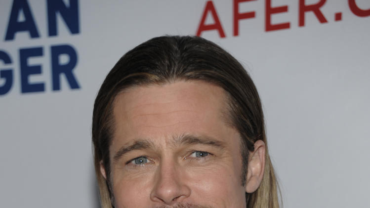 """FILE In this Saturday, March 3, 2012 file photo, actor Brad Pitt arrives at the Los Angeles premiere of the play """"8"""" in Los Angeles. The star-studded West Coast performance of the gay marriage play """"8"""" led by George Clooney and Brad Pitt will be heard on radio and online in early June 2012, during Gay Pride Month. (AP Photo/Dan Steinberg, File)"""