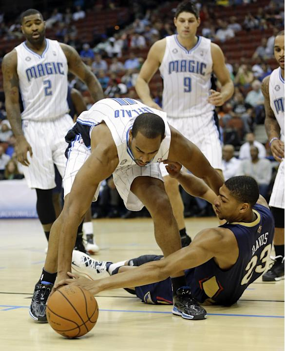 Orlando Magic's Arron Afflalo, front left, and New Orleans Pelicans' Anthony Davis (23) go after a loose ball during the first half of an NBA preseason basketball game in Jacksonville, Fla., Wednesday