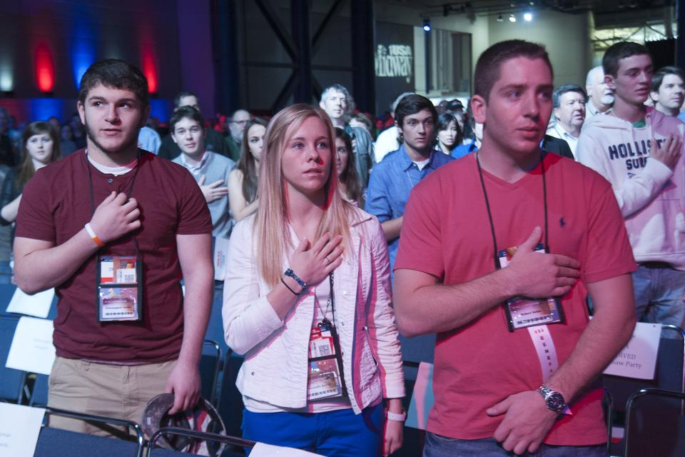 Attendees recite the Pledge of Allegiance during the opening of the leadership forum at the National Rifle Association's  annual convention Friday, May 3, 2013 in Houston. (AP Photo/Steve Ueckert)
