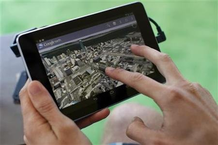 An attendee uses Google Map on a Google Nexus 7 tablet during Google I/O 2012 Conference at Moscone Center in San Francisco