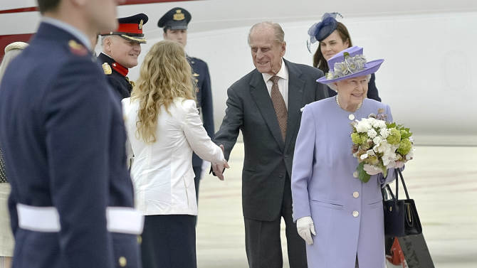 Queen Elizabeth II, accompanied by Prince Philip arrives at Rome's Ciampino military airport to start their one-day visit to Italy and the Vatican, Thursday, April 3, 2014. The British Royals will meet Italian President Giorgio Napolitano during an official lunch at the Quirinale Presidential Palace and Pope Francis at the Vatican in the afternoon. (AP Photo/Daniele Leone) Photo LaPresse 04-03-2014 Rome (Italy) News Queen Elizabeth and Prince Philip arrive at Ciampino airport
