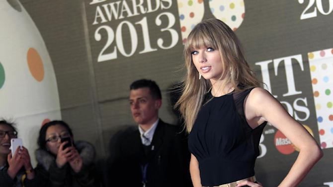 Taylor Swift seen arriving at the BRIT Awards 2013 at the o2 Arena in London on Wednesday, Feb. 20, 2013. (Photo by Joel Ryan/Invision/AP)