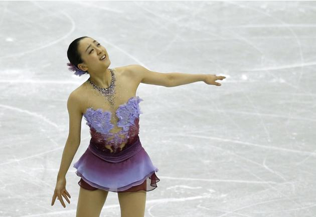 Asada of Japan performs during women's short programme at ISU Grand Prix of Figure Skating Final in Fukuoka
