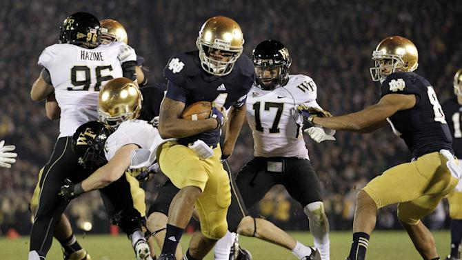 Notre Dame running back George Atkinson III scores  touchdown against Wake Forest during the second half of an NCAA college football game in South Bend, Ind., Saturday, Nov. 17, 2012. Notre Dame defeated Wake Forest 38-0. (AP Photo/Michael Conroy)