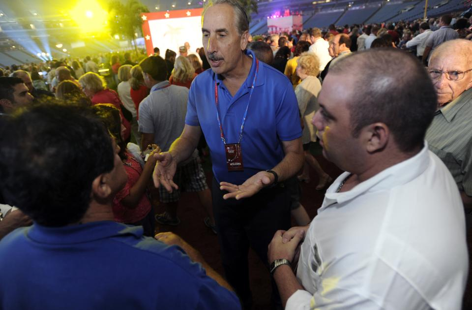 Former St. Petersburg Mayor Rick Baker speaks to guests at the 2012 Tampa Bay Host Committee's welcoming event for the delegates of the Republican National Convention on Sunday, Aug. 26, 2012 at Tropicana Field in St. Petersburg, Fla. (AP Photo/The Tampa Tribune, Chris Urso, Pool)
