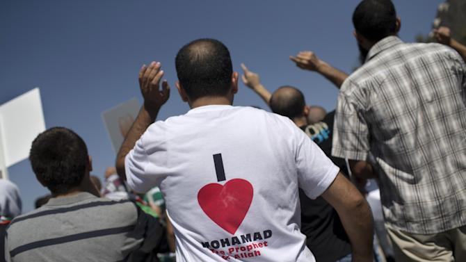 Demonstrators rally during a protest in Jerusalem, Friday, Sept. 14, 2012 as part of widespread anger across the Muslim world about a film ridiculing Islam's Prophet Muhammad. (AP Photo/Bernat Armangue)