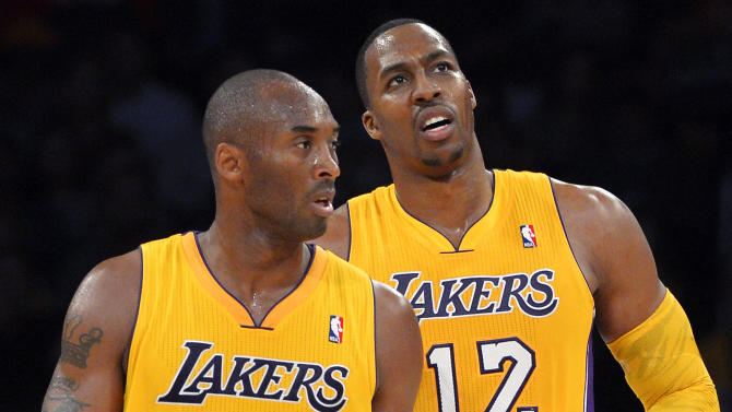 Los Angeles Lakers guard Kobe Bryant (24) and center Dwight Howard (12) appear during the first half of their preseason NBA basketball game against the Sacramento Kings, Sunday, Oct. 21, 2012, in Los Angeles. (AP Photo/Mark J. Terrill)