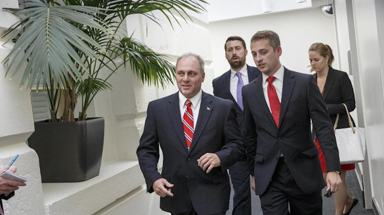 Rep. Steve Scalise, R-La., the new House GOP whip, leaves a closed-door Republican strategy session on the immigration crisis at the U.S.-Mexico border after last-minute maneuvering failed to lock down conservative support for a planned vote, at the Capitol in Washington, Thursday, July 31, 2014. The surprise developments, coming on Congress' final day of action ahead of a five-week summer recess, were an embarrassing setback for Speaker John Boehner and his leadership team as a small group of tea party lawmakers once again upset their plans. (AP Photo/J. Scott Applewhite)