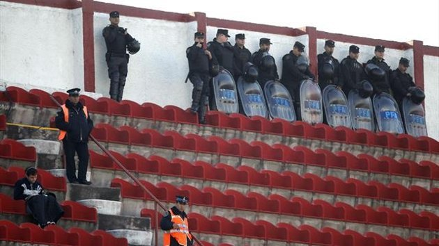 Riot policemen in the stands during an Argentine match between Velez Sarsfield and Huracan in 2011. The match was played without spectators due to a sanction imposed by the Argentine FA against Huracan (Reuters)
