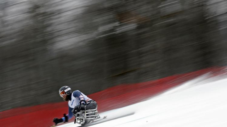 Heath Calhoun of the U.S. skis during the men's sitting skiing Super G at the 2014 Sochi Paralympic Winter Games at the Rosa Khutor Alpine Center