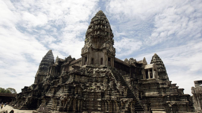In this photo taken on June 28, 2012, Cambodia's famed Angkor Wat temples complex stands in Siem Reap province, some 230 kilometers (143 miles) northwest Phnom Penh, Cambodia. Airborne laser technology has uncovered a network of roadways and canals, illustrating a bustling ancient city linking Cambodia's Angkor Wat temples complex. The discovery was announced late Monday, June 17, 2013, in a peer-reviewed paper released early by the journal Proceedings of the National Academy of Sciences. (AP Photo/Heng Sinith)