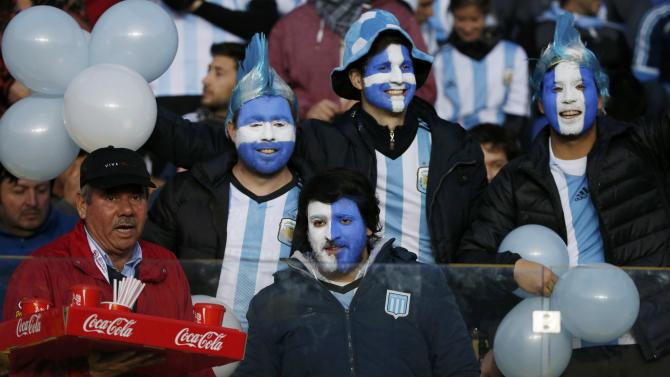 Argentina fans await the start of the team's Copa America 2015 semi-final soccer match against Paraguay at Estadio Municipal Alcaldesa Ester Roa Rebolledo in Concepcion