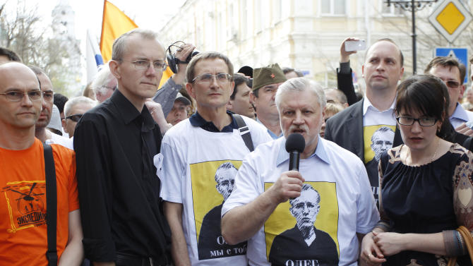Local mayoral candidate Oleg Shein, second from left, and Russian lawmaker and leader of the opposition Just Russia party Sergei Mironov, second from right, stand with other protesters during a rally in the southern Russian city of Astrakhan, Saturday, April 14, 2012. Thousands of protesters gathered in the southern Russian city of Astrakhan in support of hunger-striking politician, Shein, who claims election fraud in the mayoral race last month. Shein, a member of the Just Russia party who ran for mayor in Astrakhan, has been on a hunger strike for a month. He and supporters allege rampant fraud in favor of a Kremlin-backed candidate. (AP Photo/Yevgeny Polonsky)