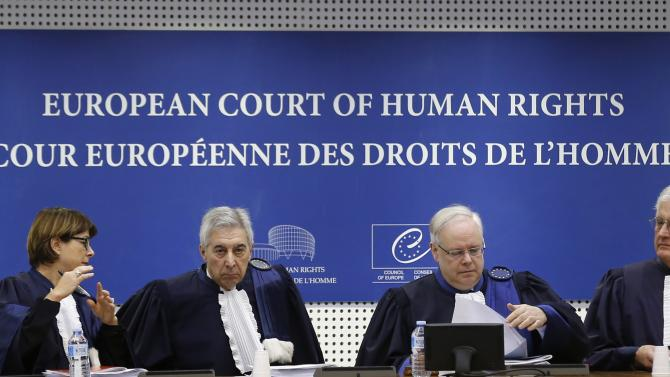 Judges of the European Court of Human Rights sit in the courtroom at the start of a hearing at the European Court of Human Rights in Strasbourg