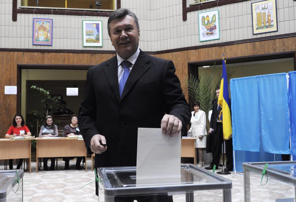 Ukrainian President Viktor Yanukovich casts his ballot at a polling station during parliamentary elections in Kiev, Ukraine, Sunday, Oct. 28, 2012. (AP Photo/Sergei Chuzavkov)