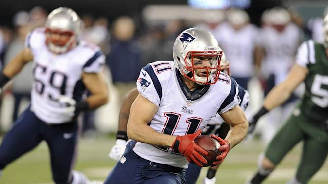 New England Patriots' Julian Edelman (11) returns a fumble for a touchdown during the first half of an NFL football game against the New York Jets, Thursday, Nov. 22, 2012, in East Rutherford, N.J. (AP Photo/Bill Kostroun)