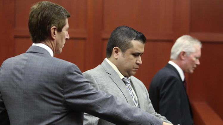 George Zimmerman arrives in Seminole circuit court with his attorney, Mark O'Mara, left, in Sanford, Fla., for a pre-trial hearing Friday, June 7, 2013. Circuit Judge Debra Nelson is listening Friday to testimony from voice experts about whether witnesses with expertise in speech identification should be allowed to testify when Zimmerman's trial starts next week.  (AP Photo/Orlando Sentinel, Joe Burbank, Pool)