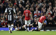 Manchester United's Rio Ferdinand, right, reacts as a penalty is given after a tackle on Newcastle United's Hatem Ben Afrfa, bottom left, during their English Premier League soccer match at Old Trafford Stadium, Manchester, England, Saturday Nov. 26, 2011. (AP Photo/Jon Super)