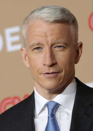 "FILE - In a Nov. 20, 2010 file photo, Anderson Cooper arrives at ""CNN Heroes: An All-Star Tribute"" awards show in Los Angeles. Cooper is bringing his talents to Broadway- his voice, that is. The newsman will play the narrator in the upcoming revival of ""How to Succeed in Business (Without Really Trying)."" Cooper is following in the footsteps of Walter Cronkite who was the voice of the narrator in the 1995 revival of the musical starring Matthew Broderick. The part is prerecorded.  (AP Photo/Dan Steinberg, File)"